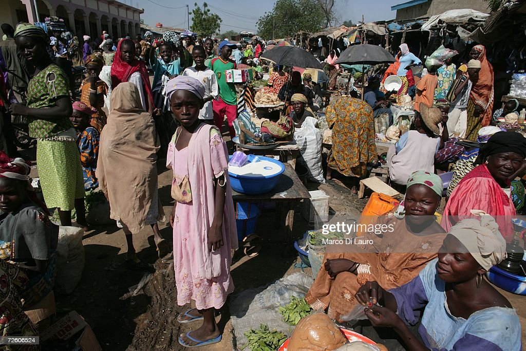 N'DJAMENA CHAD NOVEMBER 4 Chadians walk in the market on November 4 2006 in N'Djamena Chad Chad declared a state of emergency in large areas of...
