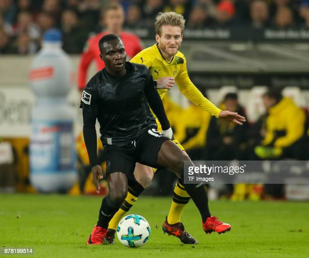 Chadrac Akolo of Stuttgart and Andre Schuerrle of Dortmund battle for the ball during the Bundesliga match between VfB Stuttgart and Borussia...