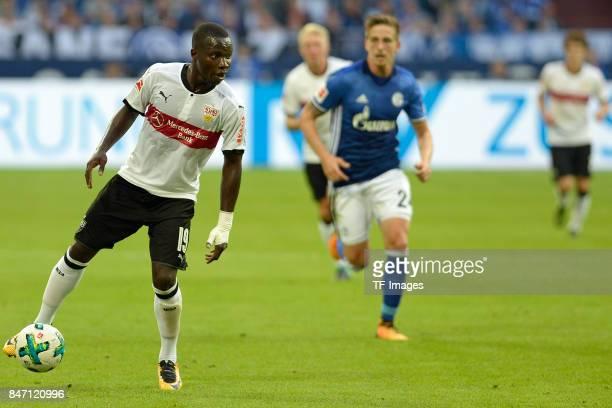 Chadrac Akolo of Stuttgart and Bastian Oczipka of Schalke controls the ball during the Bundesliga match between FC Schalke 04 and VfB Stuttgart at...