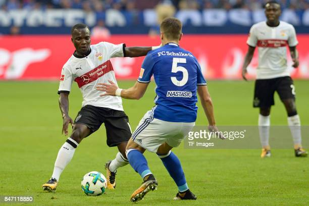 Chadrac Akolo of Stuttgart and Matija Nastasic of Schalke battle for the ball during the Bundesliga match between FC Schalke 04 and VfB Stuttgart at...