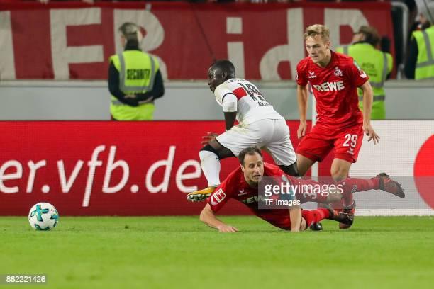Chadrac Akolo of Stuttgart and Matthias Lehmann of Koeln battle for the ball during the Bundesliga match between VfB Stuttgart and 1 FC Koeln at...