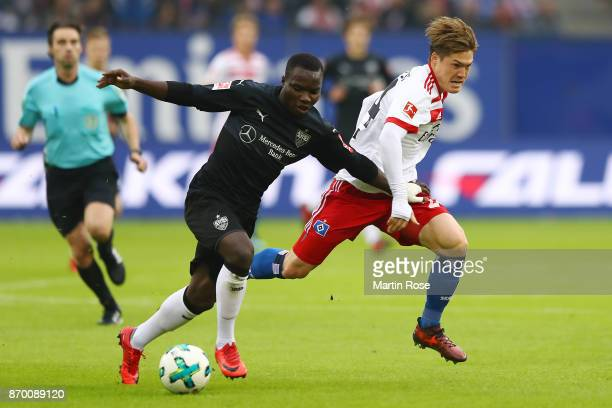 Chadrac Akolo of Stuttgart fights for the ball with Gotoku Sakaiof Hamburg during the Bundesliga match between Hamburger SV and VfB Stuttgart at...