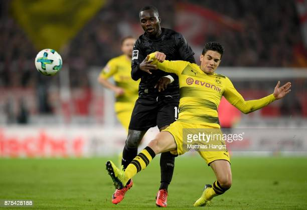 Chadrac Akolo of Stuttgart is challenged by Marc Bartra of Dortmund during the Bundesliga match between VfB Stuttgart and Borussia Dortmund at...