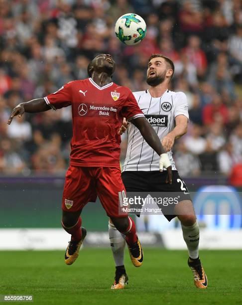 Chadrac Akolo of Stuttgart jumps for a header with Marc Stendera of Frankfurt during the Bundesliga match between Eintracht Frankfurt and VfB...