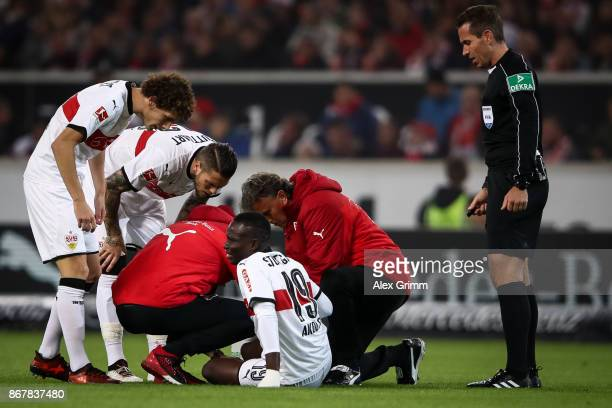 Chadrac Akolo of Stuttgart receives medical help during the Bundesliga match between VfB Stuttgart and SportClub Freiburg at MercedesBenz Arena on...