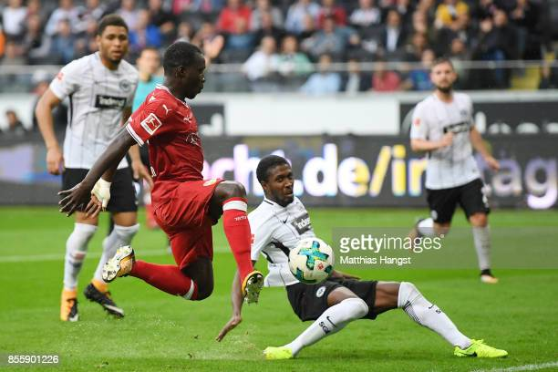 Chadrac Akolo of Stuttgart with Taleb Tawatha of Frankfurt during the Bundesliga match between Eintracht Frankfurt and VfB Stuttgart at...