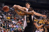Chadrack Lufile of the Wichita State Shockers blocks out Steven Adams of the Pittsburgh Panthers in the first half during the second round of the...
