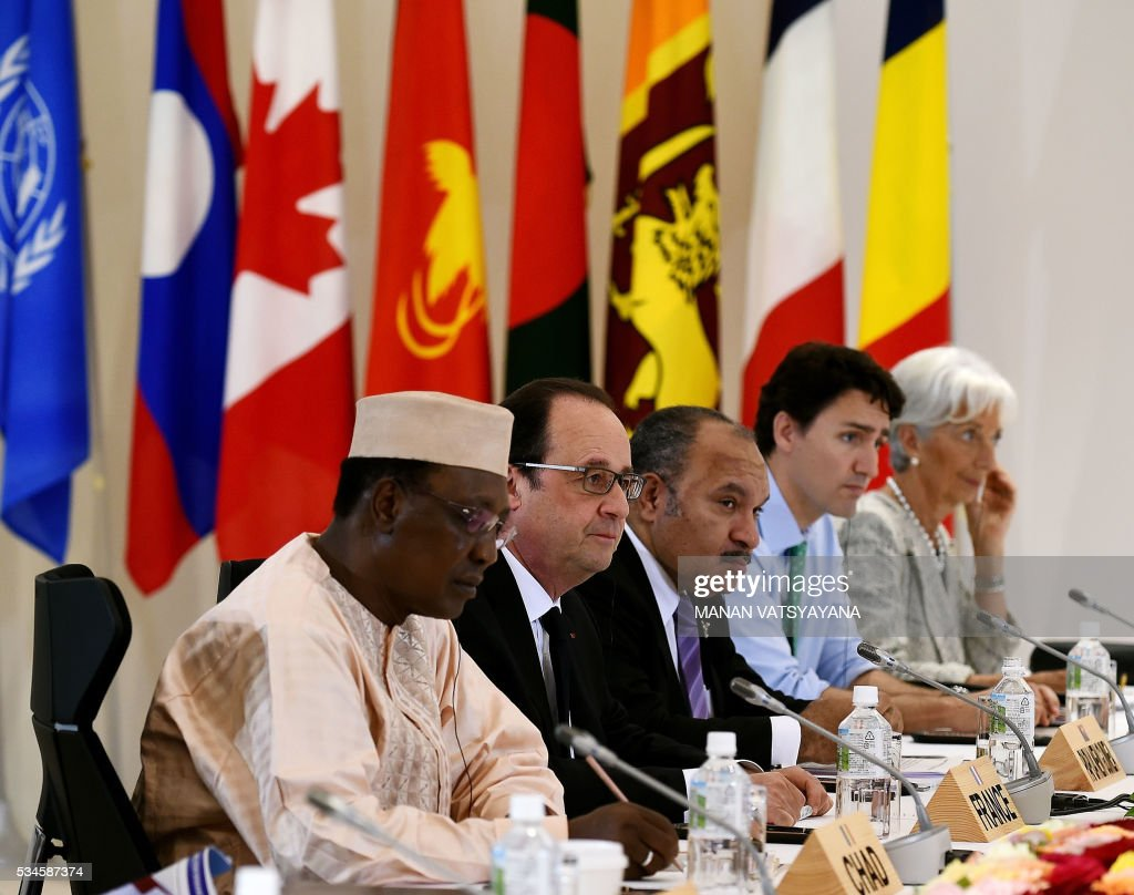 Chad's President Idriss Deby, French President Francois Hollande, Papua New Guinea's Prime Minister Peter O'Neill, Canadian Prime Minister Justin Trudeau and International Monetary Fund (IMF) Managing Director Christine Lagarde attend the Outreach Session of the 2016 Ise-Shima G7 summit in Shima in Mie prefecture on May 27, 2016. Leaders from the Group of Seven advanced democracies met with representatives of emerging and developing countries in Asia and Africa. The so-called outreach programme involves Chad, Indonesia, Sri Lanka, Bangladesh, Papua New Guinea, Vietnam and Laos. / AFP / POOL / Richard BROOKS
