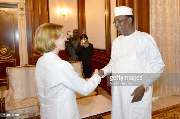Chad's President Idriss Deby Itno shakes hands with France Minister of Army Forces Florence Parly before their meeting at the presiedential palace in...