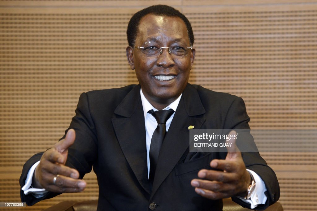 Chad's President Idriss Deby Itno smiles while talking during a press conference at France's largest employers' union Medef on December 6, 2012 in Paris. Deby Itno on December 5 denounced the confusion surrounding plans for a UN-backed military intervention to oust Islamists in control of northern Mali. AFP PHOTO / BERTRAND GUAY