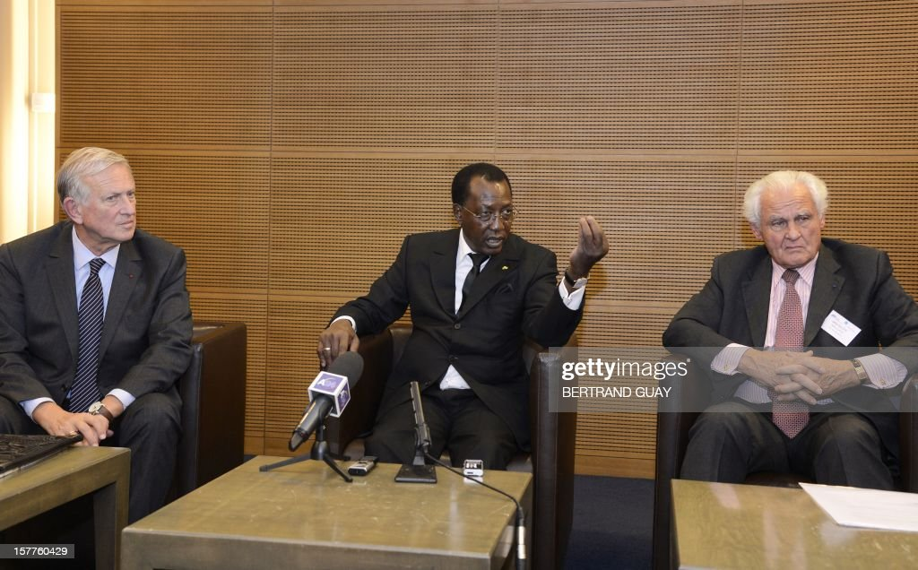 Chad's President Idriss Deby Itno (C) talks during a joint press conference with Michel Roussin, Vice-President of France's largest employers' union Medef (L) and Patrick Lucas, President of insurance company Gras Savoye at the Medef headquarters in Paris on December 6, 2012. Deby Itno on December 5 denounced the confusion surrounding plans for a UN-backed military intervention to oust Islamists in control of northern Mali. AFP PHOTO / BERTRAND GUAY
