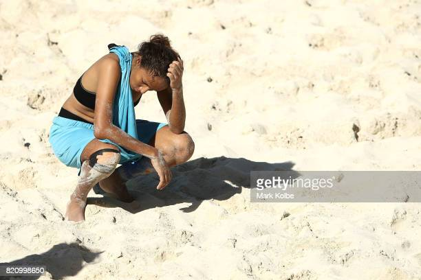 Chadwick Russell of the Bahamas looks dejected after defeat during the girl's beach soccer bronze medal final match between the Bahamas and Turks...