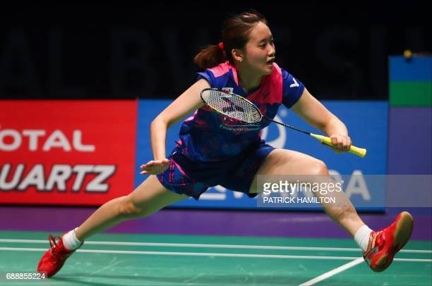 Chae Yoo Jung of South Korea hits a return during the mixed doubles Sudirman Cup match with partner Choi Solgyu against Dechapol Puavaranukroh and...