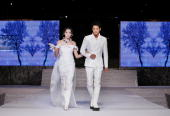 Chae Young and Park SiHoo showcase designs by Korean couture designer Andre Kim at the opening catwalk show on the first day of Bali Fashion Week...