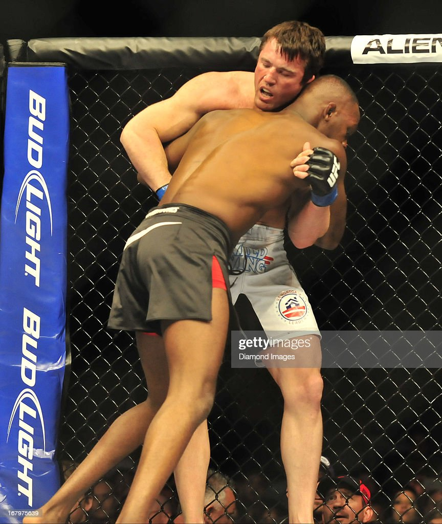 Chael Sonnen is pinned up against the cage by Jon Jones during a light-heavyweight bout during UFC 159 Jones v. Sonnen at Prudential Center in Newark, New Jersey.