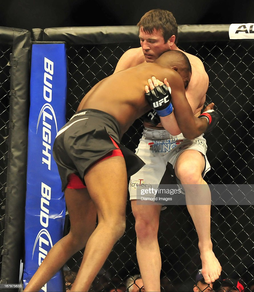 Chael Sonnen throws a knee to the body of Jon Jones during a light-heavyweight bout during UFC 159 Jones v. Sonnen at Prudential Center in Newark, New Jersey.