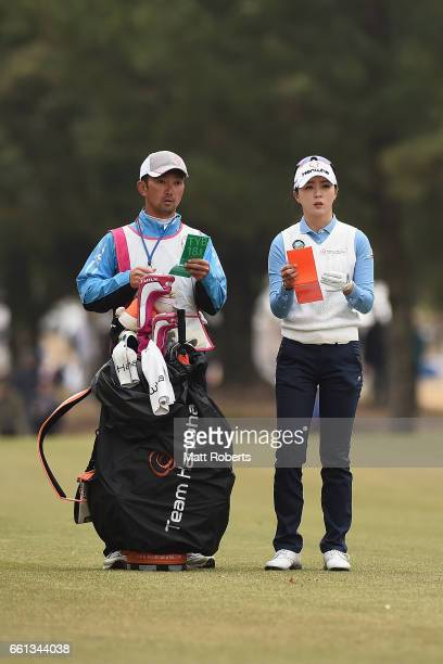 ChaeYoung Yoon of Korea looks at her yardage book the first hole during the second round of the YAMAHA Ladies Open Katsuragi at the Katsuragi Golf...