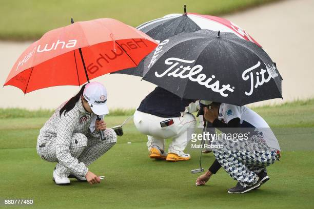 ChaeYoung Yoon of South Korea Hiroko Azuma of Japan and P Chutichai of Thailand inspect the 2nd green during the first round of the Fujitsu Ladies...