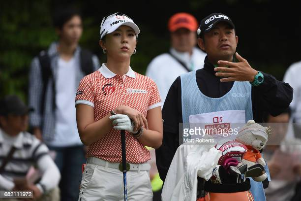 ChaeYoung Yoon of South Korea speaks with her caddie on the 10th hole during the first round of the HokennoMadoguchi Ladies at the Fukuoka Country...