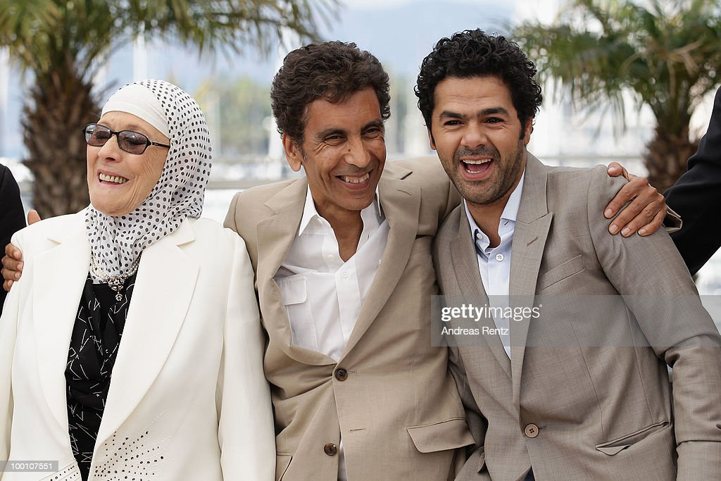 Chafia Boudraa, Director Rachid Bouchareb and Jamel Debbouze attend the 'Outside Of The Law' Photocall at the Palais des Festivals during the 63rd Annual Cannes Film Festival on May 21, 2010 in Cannes, France.
