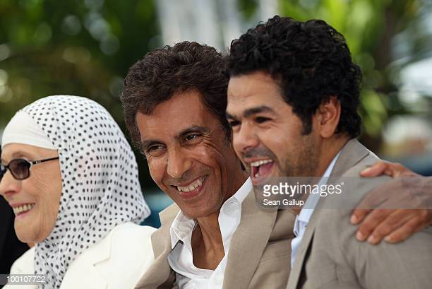 Chafia Boudraa Director Rachid Bouchareb and Jamel Debbouze attend the 'Outside Of The Law' Photocall at the Palais des Festivals during the 63rd...