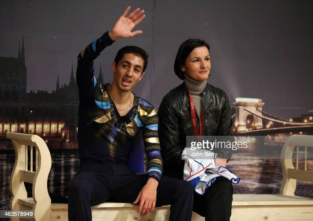 Chafik Besseghier of France with his coach Claude PeriThevenard competes in the Men Free Skating event of the ISU European Figure Skating...