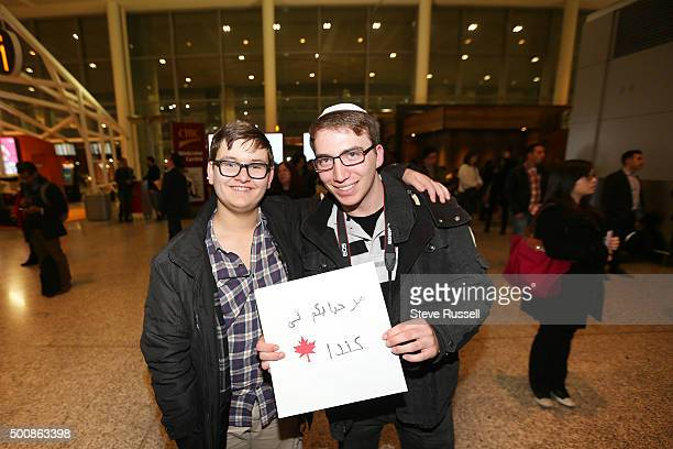 Chaim Ifrah and Shai Reef Jewish Torontonians wait at terminal one for refugees with a 'Welcome to Canada sign Syrian refugees begin to arrive in...