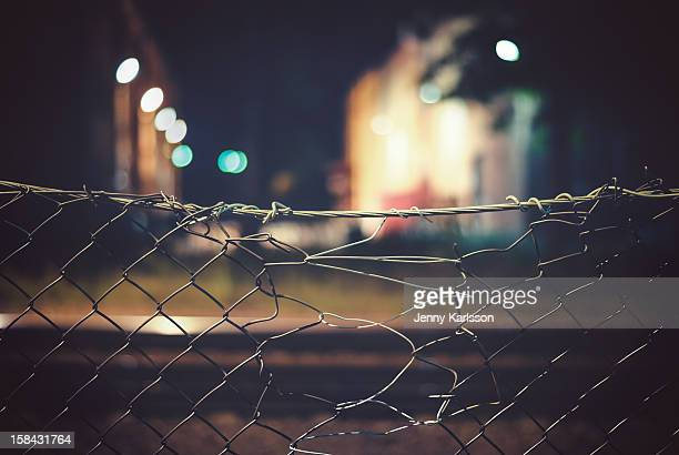 Chain link fence at railroad and industrial area