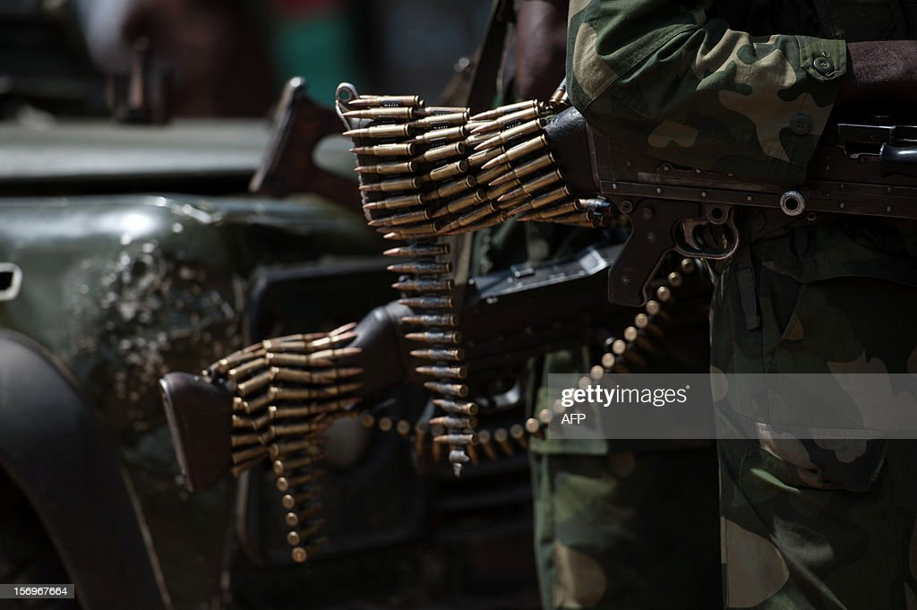 A chain of bullets hang from the butt of a rifle of a Congolese National Army soldier in in the town of Minova, in the east of the Democratic Republic of the Congo, on November 26, 2012. Minova has become a bastion of government troops after they were routed from Goma last week by M23 rebels.