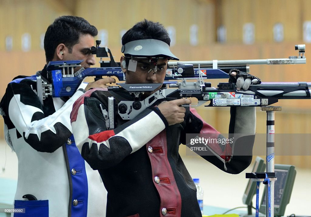 Chain Singh (L) of India and M Chowdhury (R) of Bangladesh take part in the Mens 10m Air Rifle event final during the 12th South Asian Games 2016 in Guwahati on February 12, 2016. Singh won the event and Chowdhury placed second. AFP PHOTO / Biju BORO / AFP / STRDEL