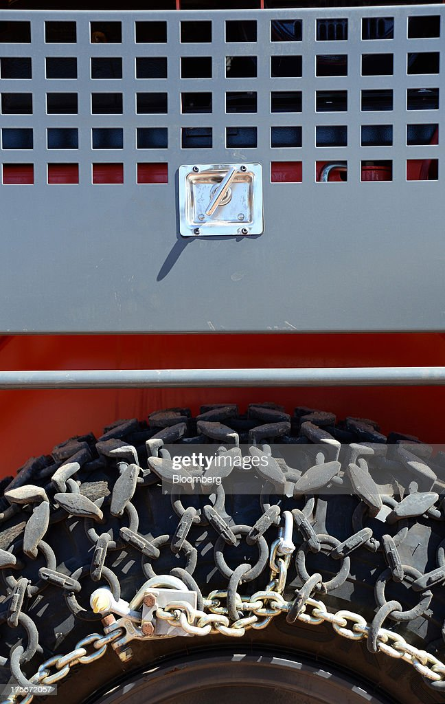 A chain sits around the tire of a truck at the Sandfire Resources NL copper operations at DeGrussa, 559 miles (900 kilometers) north of Perth, Australia, on Sunday, Aug. 4, 2013. Copper, used in electrical wiring and tubes, is expected to gain until at least 2015, according to analyst forecasts compiled by Bloomberg, as aging ore bodies and few large new discoveries keep the metal's supply and demand balance tight. Photographer: Carla Gottgens/Bloomberg via Getty Images