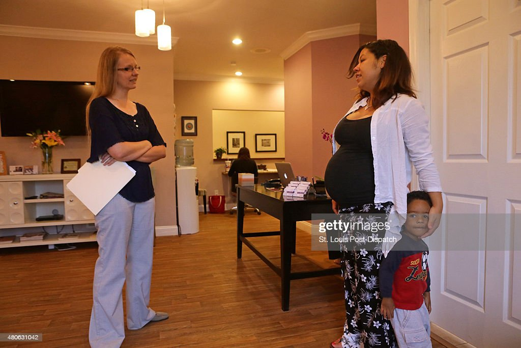 Chaina Crespo who is 39 weeks pregnant with her second child chats with Jessica Henman clinical director and midwife at the Birth and Wellness Center...