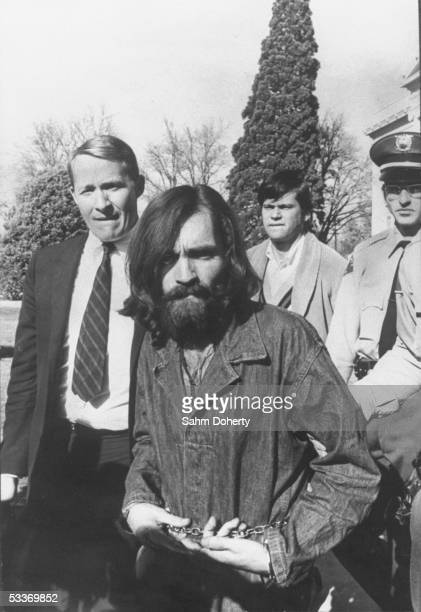 Chained cult leader Charles Manson whose hippie group is connected with the Sharon Tate murders being led from a courthouse after a hearing on...