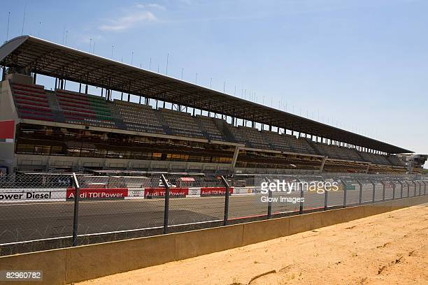 Chain-link fence in front of stadium, Le Mans, France