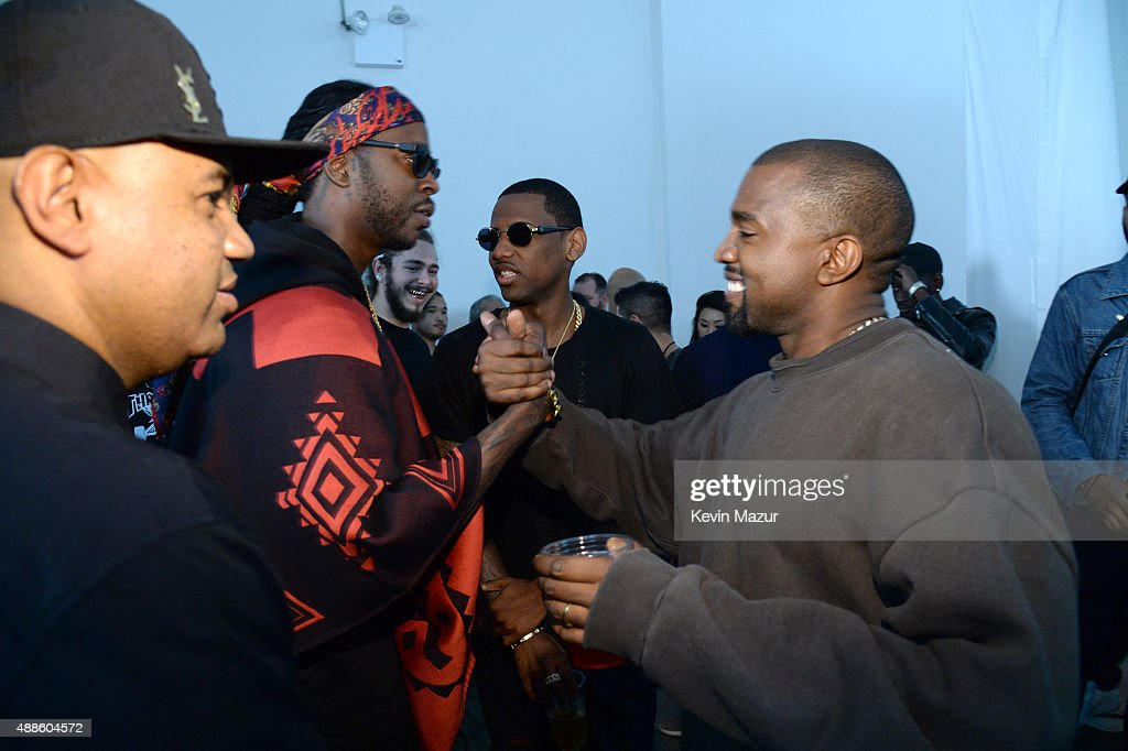 2 Chainz and Kanye West attend Kanye West Yeezy Season 2 during New York Fashion Week at Skylight Modern on September 16, 2015 in New York City.