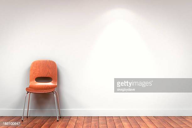 Chair against gallery wall with copyspace