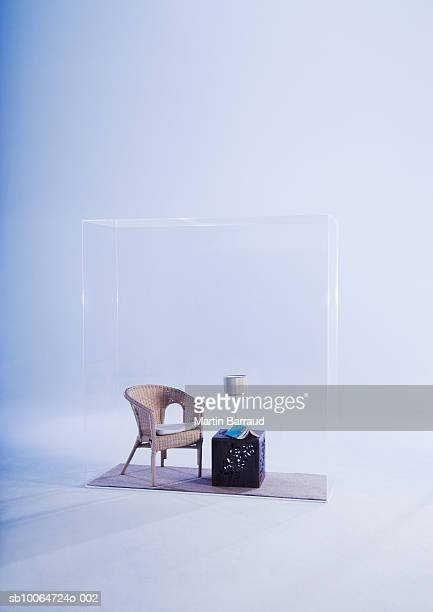 Chair and bedside table in glass cabinet
