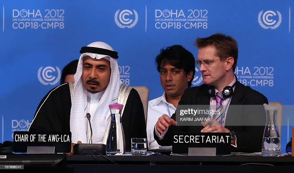Chair Aysar Tayeb of Saudia Arabia (L) and Secretary Daniel Klein, attend a press conferencea during the last day of the UN climate talks in Doha, on December 7, 2012. UN climate negotiators locked horns on the final day of talks in Doha to halt the march of global warming, deeply divided on extending the greenhouse gas-curbing Kyoto Protocol and funding for poor countries. AFP PHOTO /KARIM JAAFAR / AL-WATAN DOHA == QATAR OUT