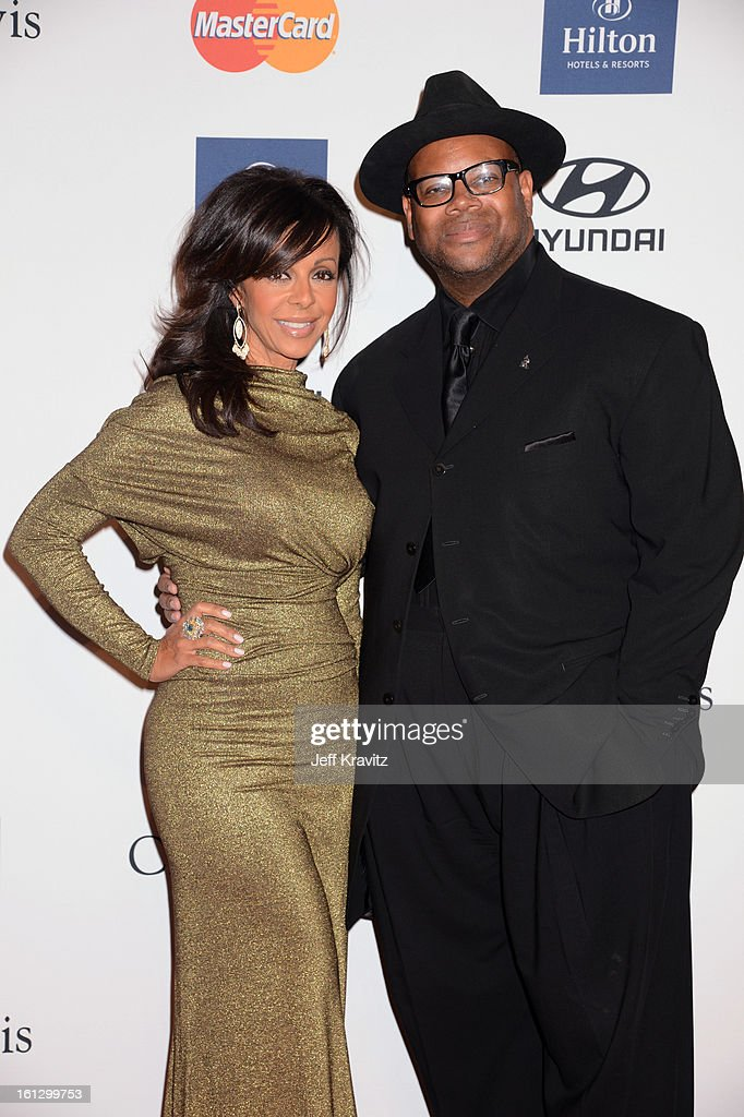 Chair Emeritus of The Recording Academy, Jimmy Jam (R) and Lisa Harris arrive at Clive Davis and The Recording Academy's 2013 GRAMMY Salute to Industry Icons Gala held at The Beverly Hilton Hotel on February 9, 2013 in Beverly Hills, California.