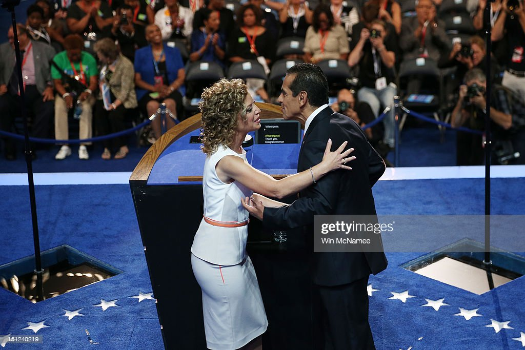 Chair Los Angeles Mayor Antonio Villaraigosa greets Democratic National Committee Chair US Rep Debbie Wasserman Schultz on stage during day one of...