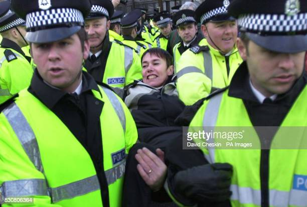 Chair of CND Carol Naughton is taken away from the gates of Faslane naval base on the River Clyde the home of Britain's Trident submarine fleet after...