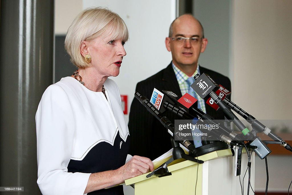 Chair of Mighty River Power Joan Withers speaks while Minister for State Owned Enterprises Tony Ryall looks on during the listing of Mighty River Power at NZX on May 10, 2013 in Wellington, New Zealand. Mighty River Power is one of several state owned enterprises being partially sold by the Government to raise capital.