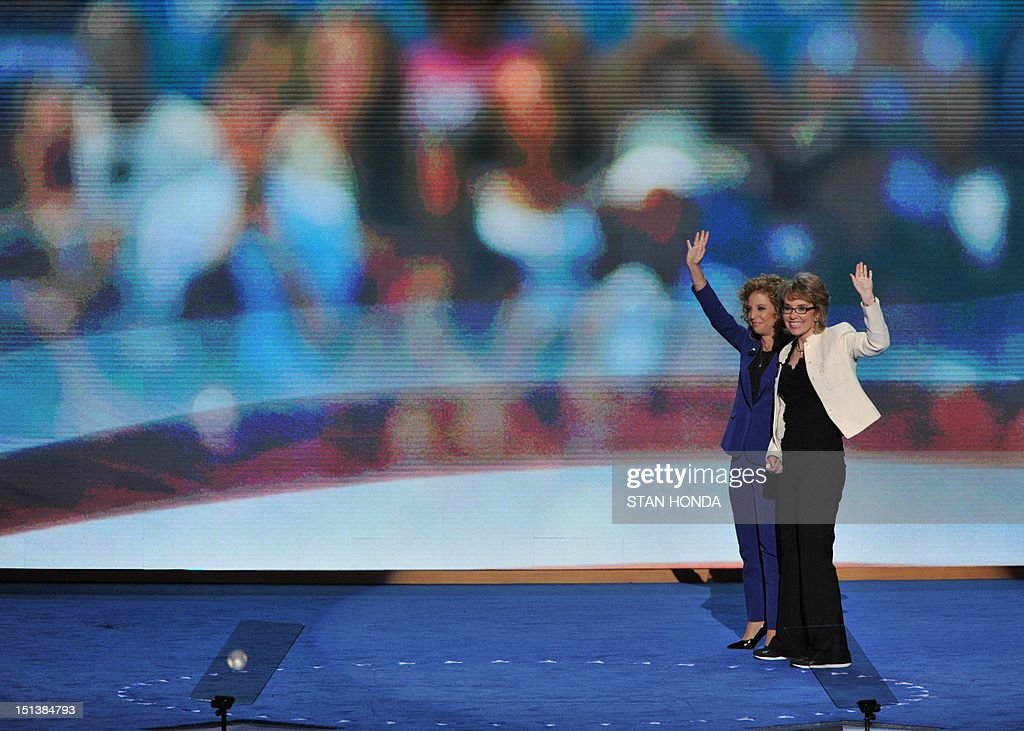 Chair of the Democratic National Committee Debbie Wasserman Schultz (L) and former congresswoman Gabrielle Giffords wave to the audience at the Time Warner Cable Arena in Charlotte, North Carolina, on September 6, 2012 on the final day of the Democratic National Convention (DNC). US President Barack Obama is expected to accept the nomination from the DNC to run for a second term as president. AFP PHOTO Stan HONDA