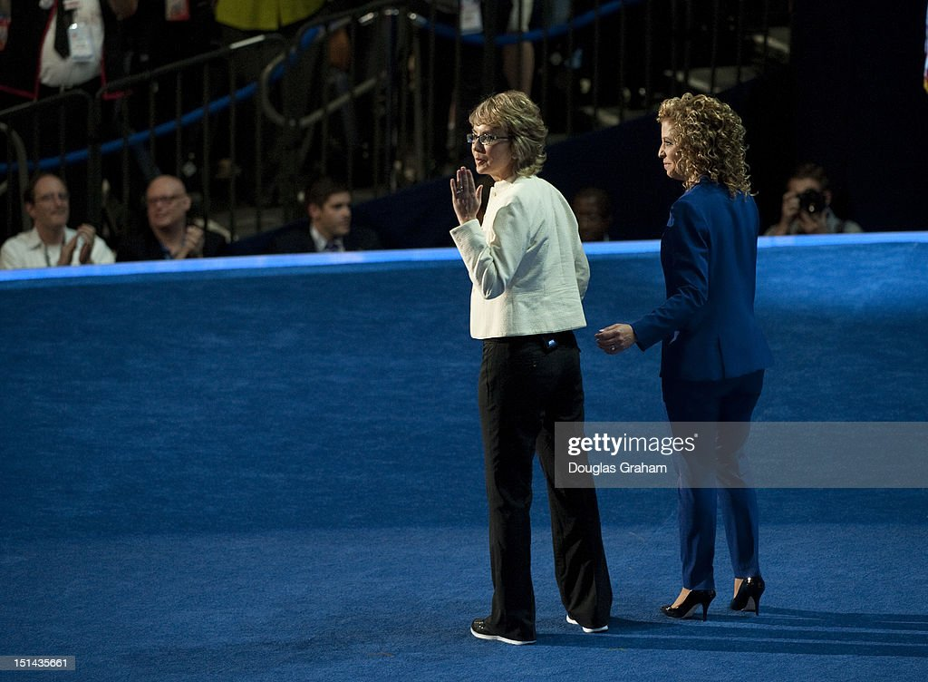 Chair of the Democratic National Committee Debbie Wasserman Schultz, right, and former Rep. Gabrielle Giffords leave the stage after Giffords delivered the Pledge of Allegiance at the Time Warner Cable Arena in Charlotte, North Carolina, on September 6, 2012 on the final day of the Democratic National Convention (DNC). US President Barack Obama is expected to accept the nomination from the DNC to run for a second term as president.