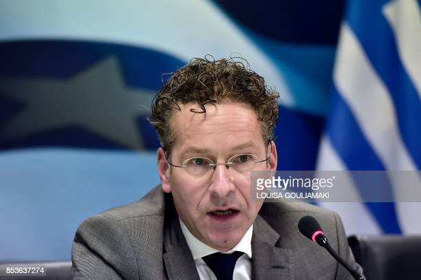 Chair of the Eurogroup finance ministers Jeroen Dijsselbloem addresses a joint press conference with Greece's Finance Minister in Athens after their...