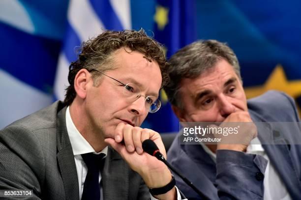 Chair of the Eurogroup finance ministers Jeroen Dijsselbloem and Greek Finance Minister Euclid Tsakalotos listen to a journalist's question during...