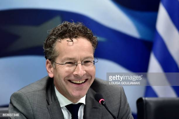 Chair of the Eurogroup finance ministers Jeroen Dijsselbloem smiles as he addresses a joint press conference with Greece's Finance Minister in Athens...