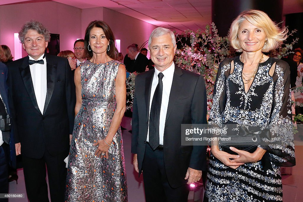 Chair of the Honorary Committee of the Gala Valerie Breton with her husband Thierry Breton and President of the National Assembly Claude Bartolone with his wife Veronique attend the AROP Charity Gala with play of 'La Traviata'. Held at Opera Bastille on June 5, 2014 in Paris, France.