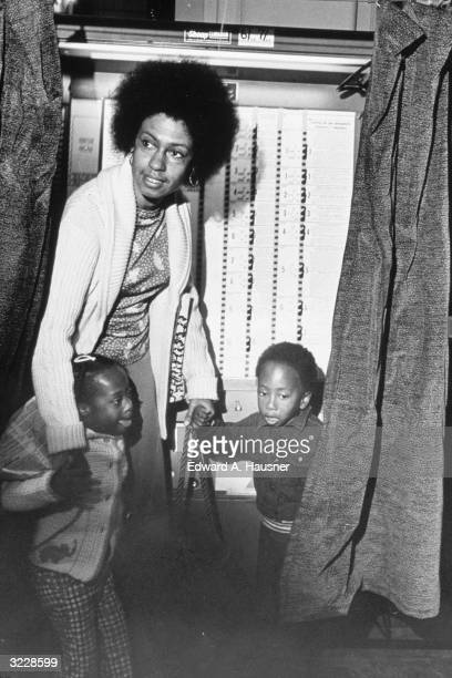 Chair of the New York City Commission on Human Rights Eleanor Holmes Norton leaving a voting booth with her children John and Katherine at a...