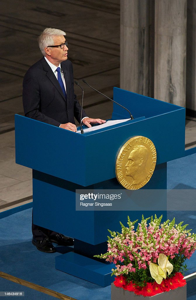 Chair of the Nobel Committee <a gi-track='captionPersonalityLinkClicked' href=/galleries/search?phrase=Thorbjorn+Jagland&family=editorial&specificpeople=862853 ng-click='$event.stopPropagation()'>Thorbjorn Jagland</a> speaks before the Nobel Peace Prize lecture by Laureate Aung San Suu Kyi at Oslo City Hall on June 16, 2012 in Oslo, Norway. Aung San Suu Kyi was awarded the Nobel Peace Price in 1991 but had been prevented from receiving it after being kept under house arrest for most of the past 24 years by Burma's military junta.